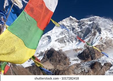 Mount Makalu with lake and buddhist prayer flags, Maklu barun national park, Nepal Himalayas