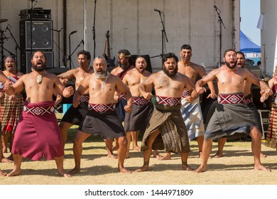 Mount Maunagnui / New Zealand - February 6 2019: Maori Men in Traditional Costume Performing a Haka, a Ceremonial Dance and Form of Challenge