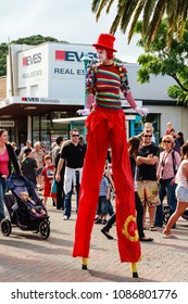 Mount Maunganui / New Zealand - April 24 2011: A Male Stilt Walker in a Clown Costume Walking Down the Street