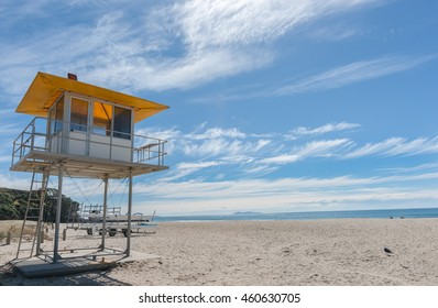 Mount Maunganui Ocean beach and lifesaver lookout blue sky with wispy white clouds passing overhead Tauranga New Zealand