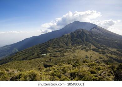 Mount Meru near Arusha in Tanzania. Africa. Mt Meru is located 60 kilometres west of Mount Kilimanjaro.