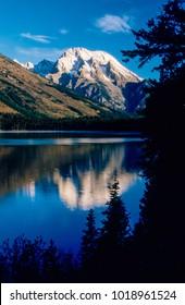 Mount Moran near Jackson, WY. is reflected in Jenny Lake.