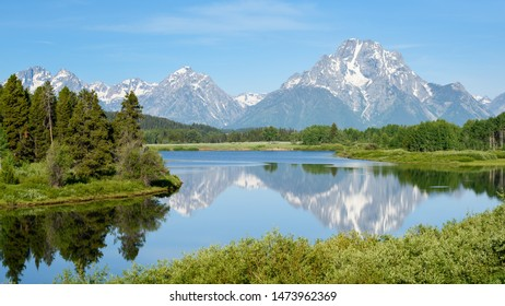 Mount Moran and the Tetons, reflected in Oxbow Bend on the Snake River, Grand Teton National Park, Wyoming.