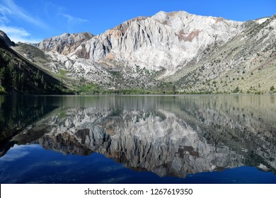 Mount Morrison mirrored in placid blue lake at Convict Lake, California