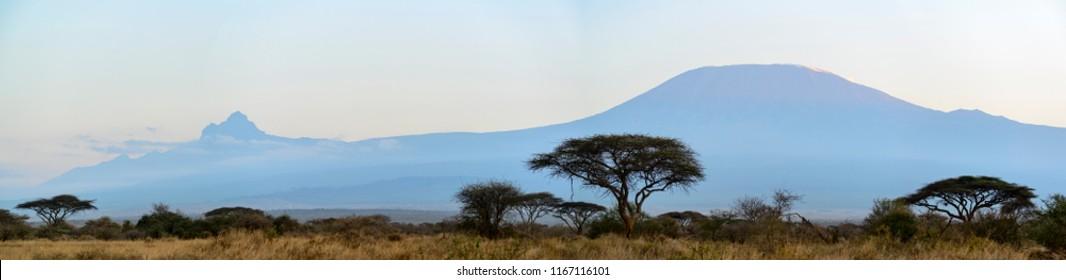 Mount (Mt) Kilimanjaro and Mount (Mt)  Mawenzi (both in in Tanzania) on the left from Satao Elerai Conservancy. Near Amboseli National Park. Kenya.