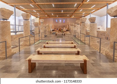 MOUNT NEBO, JORDAN - AUGUST 25, 2018: Interior of Moses Memorial Church with remains of early christian basilica