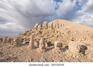 Mount Nemrut at sunrise with the head in front of the statues. The UNESCO World Heritage Site at Mount Nemrut where King Antiochus of Commagene is reputedly entombed