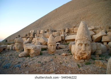 Mount Nemrut at sunrise with the head in front of the statues. The UNESCO World Heritage Site at Mount Nemrut where King Antiochus of Commagene is reputedly entombed.