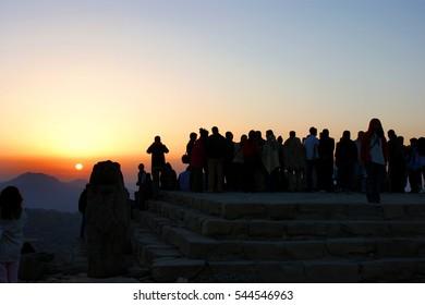 Mount Nemrut at sunrise with tourists