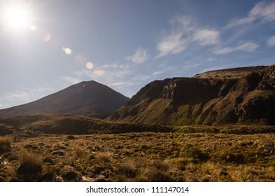 Mount Ngauruhoe with sun glare, Tongariro National Park, New Zealand