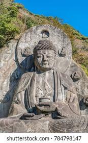 Mount Nokogiri (Nokogiriyama) Great Buddha (Nihon-ji daibutsu). Carving of seated sculpture of Yakushi Nyorai completed in 1783.  The largest pre-modern stone-carved Daibutsu in Japan