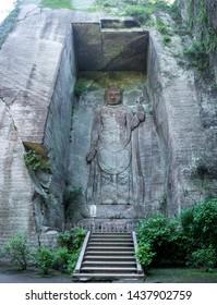 Mount Nokogiri (Nokogiriyama) Hyaku-shaku Kannon (Hundred-shaku Kannon).The Hundred-Yard buddha statue carved on a rock cliff in Nokogiri Mountain, Chiba, japan