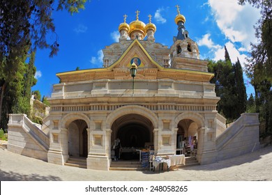 Mount of Olives in Jerusalem. The facade of the church of St. Mary Magdalene white marble.  Above the triangular portico golden domes topped with golden crosses