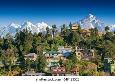 Mount Pandim (right), Mount North kabru (middle) and Mount South Kabru (left) Himalayan Mountain range - with top of Rinchenpong town in foreground, clear blue sky above. Rinchenpong, Sikkim, India