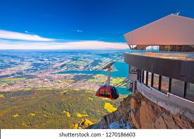 Mount Pilatus aerial cabelway above cliffs and Lake Lucerne landscape, Switzerland