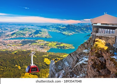 Mount Pilatus aerial cabelway above and town of Luzern aerial view, central Switzerland landscape