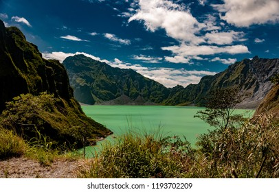 Mount Pinatubo Crater Lake seen here from the entrance area. Around the crater you can see the hugh mounds of ash.