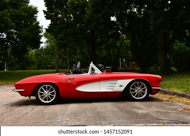 Mount Pleasant, Wisconsin / USA - July 21, 2019: An early 1960's Chevrolet Corvette red with white color inset.