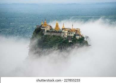 Mount Popa over the cloud the home of Nat the Burmese mythology ghost this place is the old volcano in Myanmar.