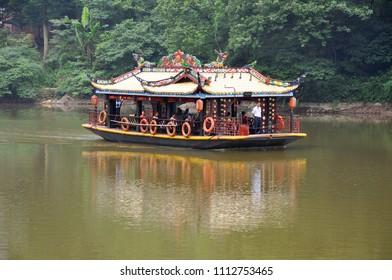 Mount Qingcheng, Sichuan, China - JUN. 21, 2012: Antique tourism boat on Yuecheng Lake in Mount Qingcheng Shan in Dujiangyan, Sichuan, China. Mount Qingcheng is UNESCO World Heritage Site