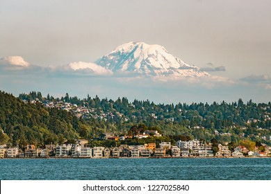 Mount Rainier emerging from the clouds above Seattle from Elliott Bay, Puget Sound, Washington state, USA.