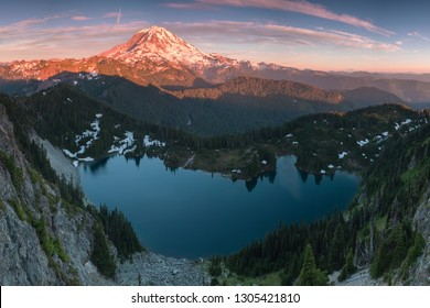 Mount Rainier and Eunice Lake as seen from Tolmie Peak. View of volcano with a lake in the foreground  Scenic view of Mount Rainier reflected across the reflection lakes at sunset.