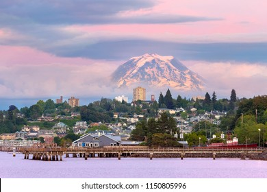 Mount Rainier over Tacoma Washington waterfront during alpenglow sunset evening