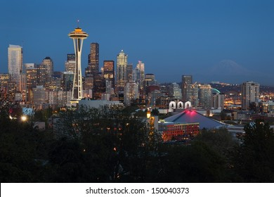 Mount Rainier, Seattle Twilight. Seattle, Washington skyline at twilight. The landmark Space Needle lit up as Mt. Rainier fades in the background. USA.