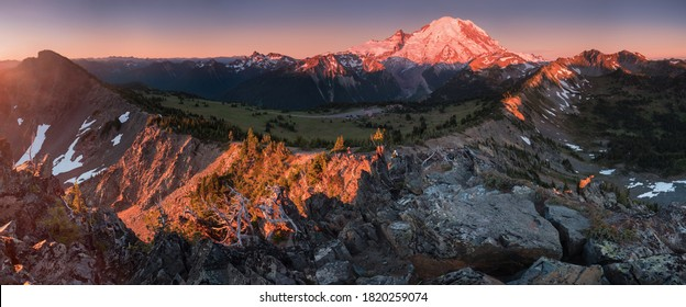 Mount Rainier towers over the surrounding mountains sitting at an elevation of 14,411 ft. It is considered to be one of the world's most dangerous volcanoes. Wonderful Nature landscape. Popular place - Shutterstock ID 1820259074