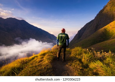 MOUNT RINJANI, LOMBOK, INDONESIA. SEPT 17th 2017: Unidentified hikers start their journey to hike Mount Rinjani from Sembalun route. Walking on trail with blue sky.