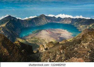 Mount Rinjani (or Gunung Rinjani) landscape at crater rim overlooking into crater lake and its volcanic mountain. Mountain Rinjani is an active volcano in Indonesia on the island of Lombok.
