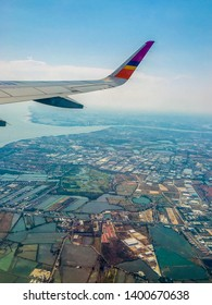 Mount of a river, land and sky in Samut Prakan province through airplane window. Thai Smail Airways flight WE 291. From Suwannabhumi International Airport to Narathiwat Airport, 14 April 2019.