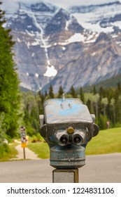 MOUNT ROBSON, BRITISH COLUMBIA, CANADA - JUNE 2018: Binocular viewing device for tourists with Mount Robson in the background.