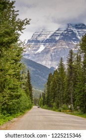 MOUNT ROBSON, BRITISH COLUMBIA, CANADA - JUNE 2018: Open road in the Mount Robson Provincial Park in British Columbia, Canada. The mountain dominates the background.