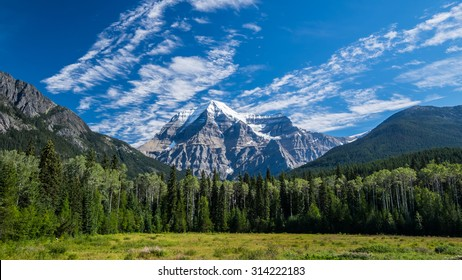 Mount Robson rises from the landscape in Robson Provincial Park, British Columbia, Canada.