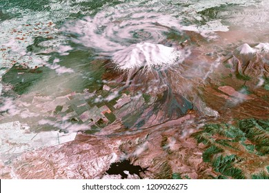 Mount Ruapehu, New Zealand. Snow-capped Ruapehu Volcano covered by hurricane clouds, collage, with clear landscape+hurricane. Satellite view. Elements of this image furnished by NASA.