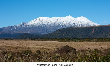 Mount Ruapehu with peaks covered in snow in the distance in New Zealand