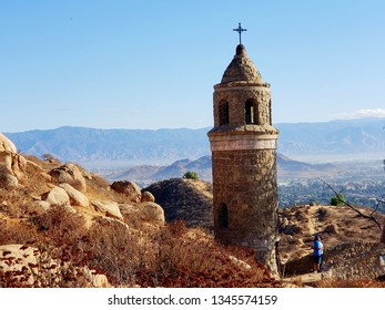 mount Rubidoux hiking trail in Riverside California.ancient bricks church bell tower with smokey mountains,September 30,2018.two people resting on a bridge