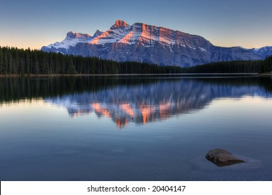 Mount Rundle and Johnson Lake in the Canadian Rockies at sunset