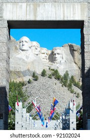 Mount Rushmore and alley of state flags through a stone doorway