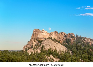 Mount Rushmore with the moon visible near Keystone, South Dakota