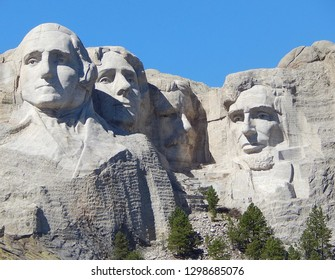 Mount Rushmore National Memorial in the Black Hills of South Dakota. The faces of Presidents George Washington, Abraham Lincoln, Theodore Roosevelt, and Thomas Jefferson are carved in stone.