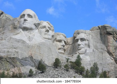 Mount Rushmore National Memorial The sixty foot faces of past United States President's.  George Washington, Thomas Jefferson, Theodore Roosevelt,Abraham Lincoln carved in granite.