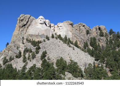 Mount Rushmore showing George Washington, Thomas Jefferson, Teddy Roosevelt and Abraham Lincoln - National Monument in South Dakota