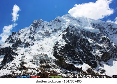 Mount Salkantay, Peru - snowy mountain peak with pack mules