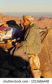 Mount Sinai, Qesm Sharm Ash Sheikh, South Sinai Governorate / Egypt - 02.04.2019. Root resident of the Sinai Peninsula sells stones. Bedouin village in the mountains.
