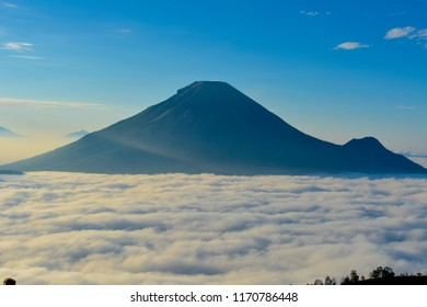 Mount sindoro is seen from the top of the Hill sikunir Dieng, Wonosobo