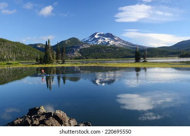 Mount Sister with reflection over a lake in Oregon