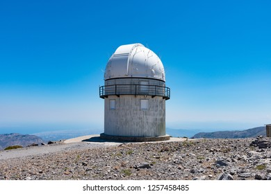 Mount Skinakas Peak astronomical observatory dome overlooking Heraklion city coastline, Crete, Greece. Sky astrophysical observatory at 2000m on Psiloritis mountain range. Astronomy concept.