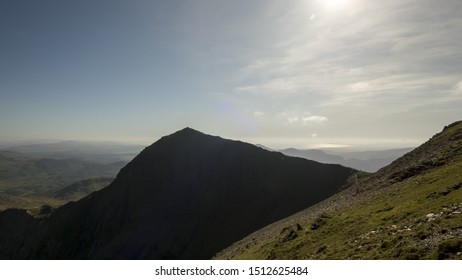 Mount Snowdon in Snowdonia, Wales UK backlit with sunlight